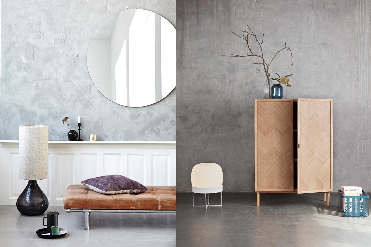 Helle Möbel und farbige Accessoires sind zu sehen, die den Warm Nordic Living-Trend am besten beschreiben